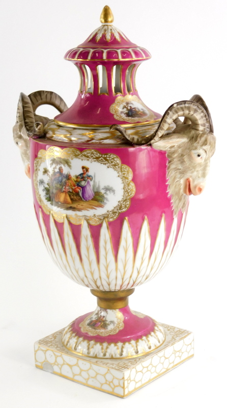 A late 19thC German porcelain two handled vase and cover, the lid with a gilt finial and pierced sid