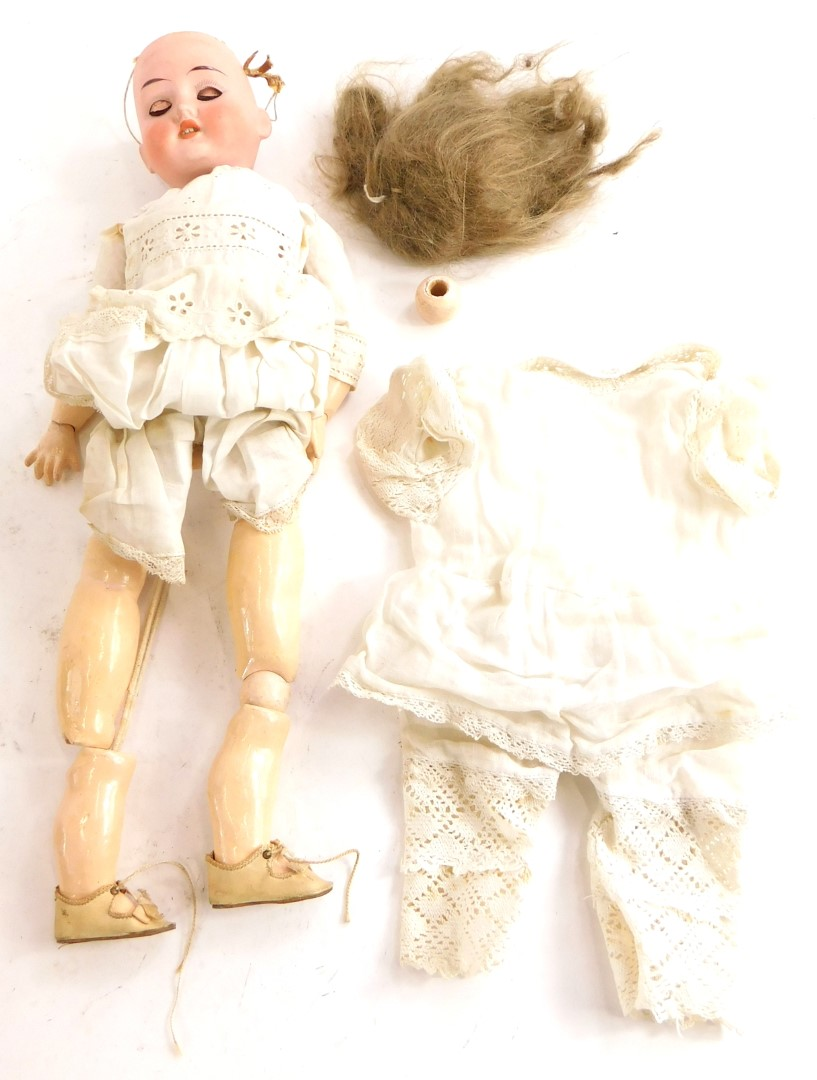 A bisque headed doll, the reverse stamped 1909, 0 Germany, with composition limbs etc. (AF).