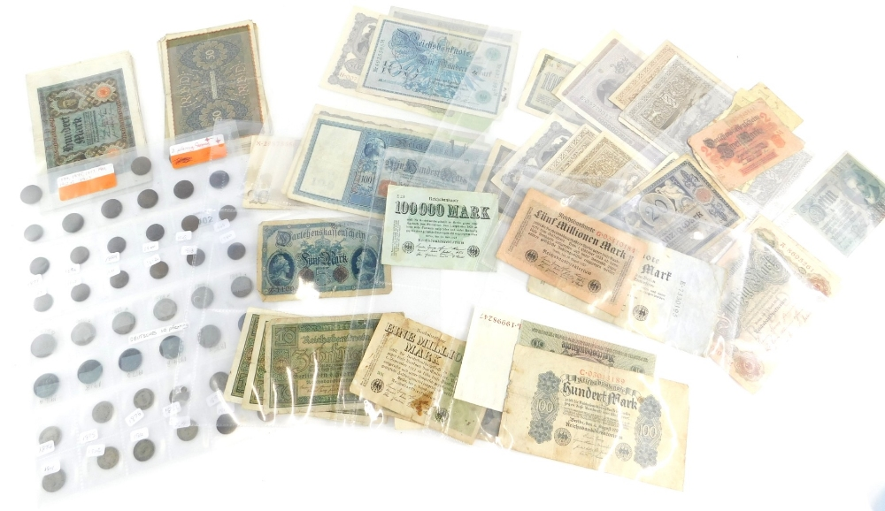Approximately sixty German banknotes and a quantity of coins, all pre 1940.