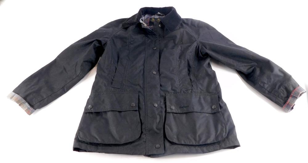 A ladies Barbour black wax jacket, size 14.