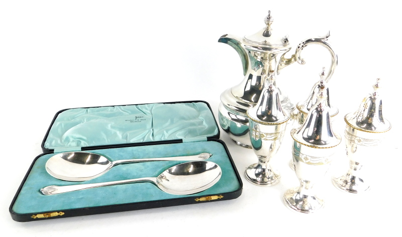 A collection of silver plated wares, to include a set of four urn shaped salt and pepper pots, hot w