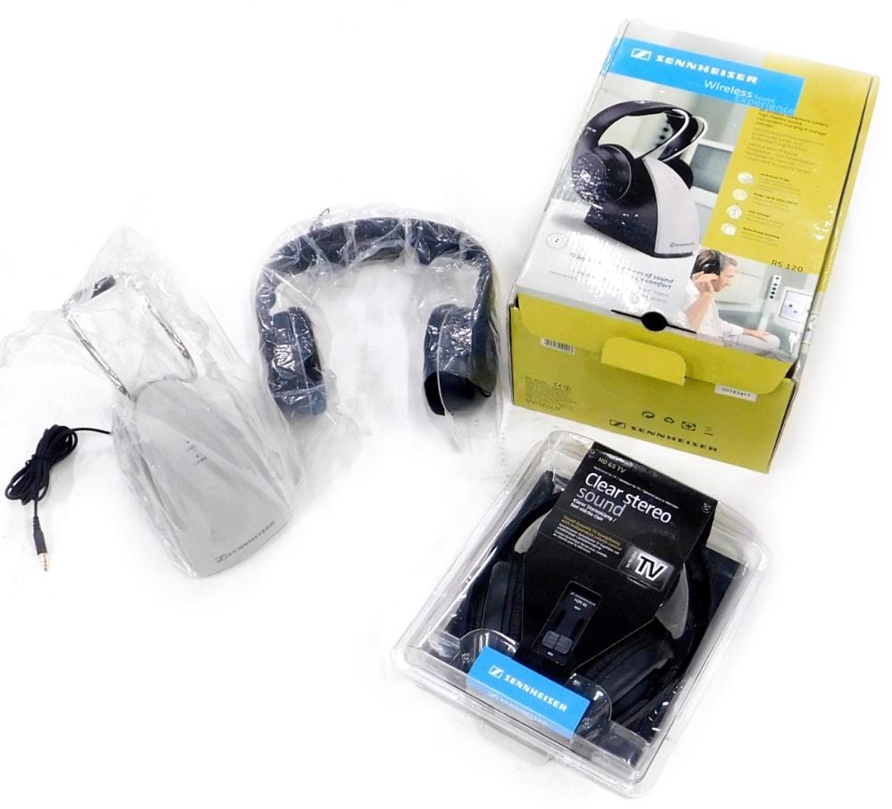 A pair of Sennheiser wireless headphones, and another pair of Sennheiser headphones.