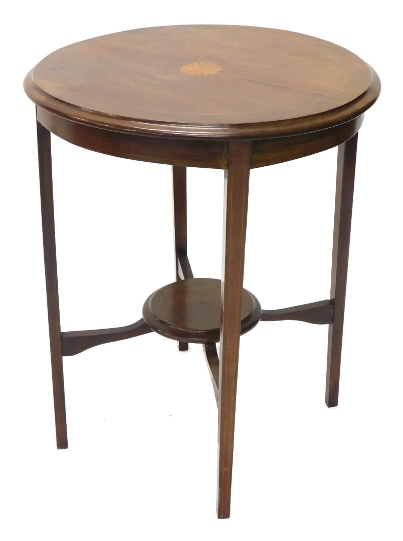 An Edwardian mahogany and boxwood strung occasional table, the circular top with a central inlaid pa