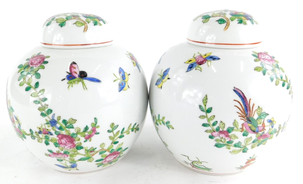 A pair of Chinese porcelain ginger jars and covers, each decorated with famile rose enamels, printed