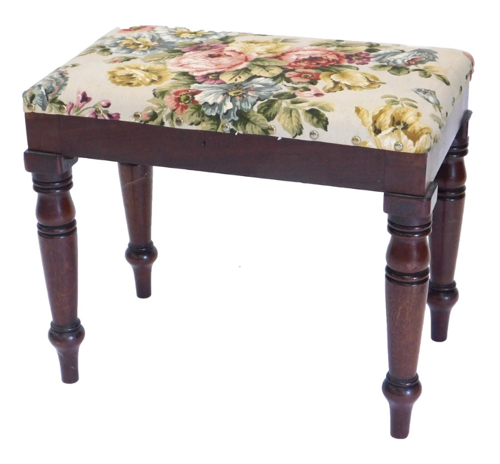 A 19thC mahogany stool, with a padded seat on turned legs.