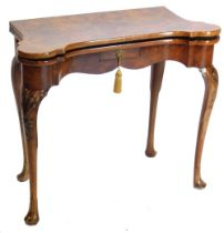 A mid 18thC walnut card table, the figured top with feather banded border and rounded corners, enclo