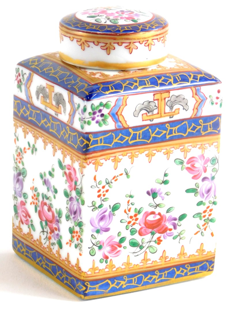 A continental porcelain square section tea caddy and lid, decorated in Chinese armorial style, unmar