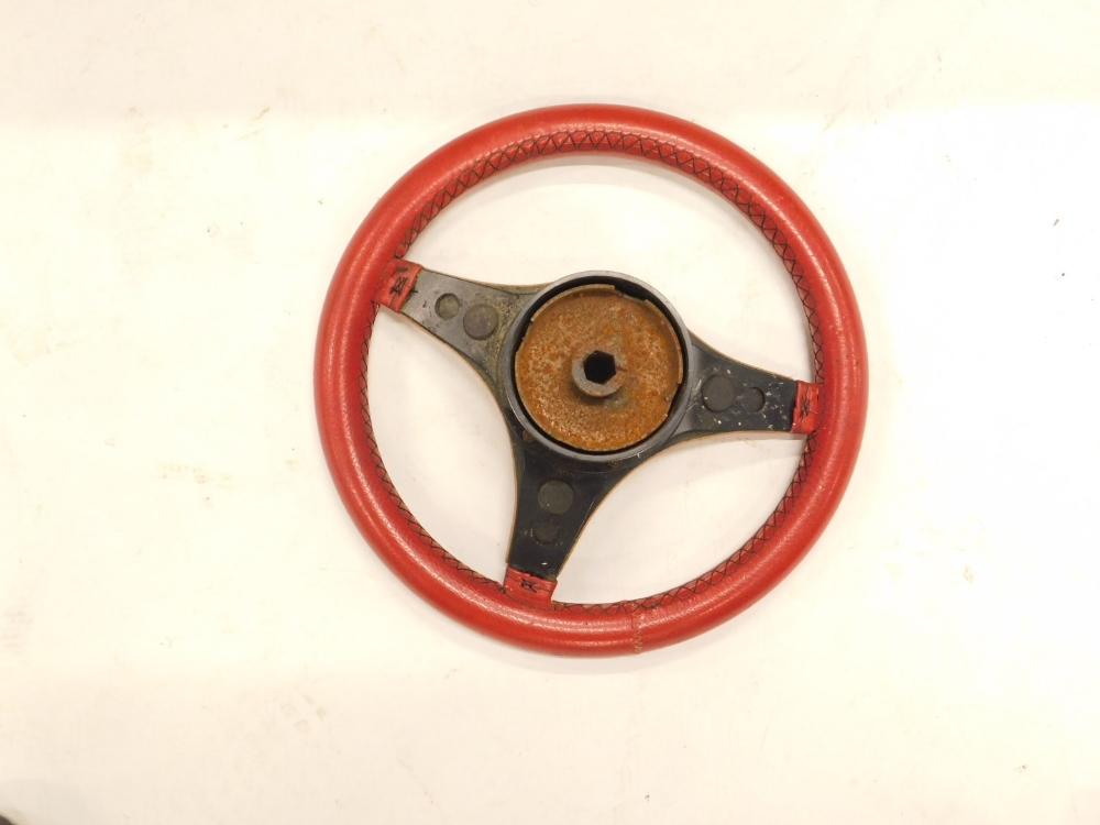 A red leather clad Ford Escort steering wheel, 33cm diameter. - Image 2 of 2
