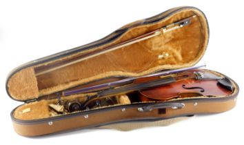 A violin, of plain form with one piece back, printed label to interior, Medio-Fino, length of back 3
