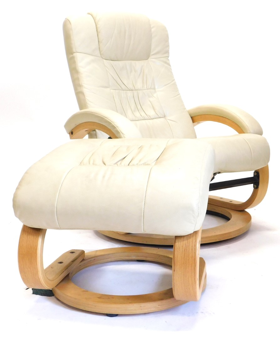 A cream leather armchair, with bentwood supports and a matching stool.