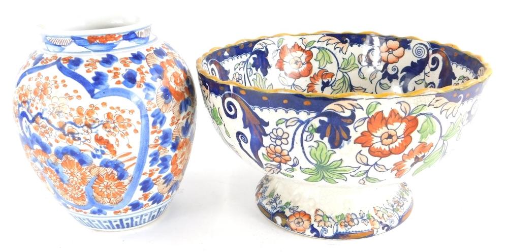 A Japanese Imari pattern porcelain vase, 21cm high, and an Amherst Japan pattern bowl. (2)