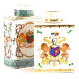 Two continental porcelain Chinese armorial style tea caddies and covers, each decorated with a crest