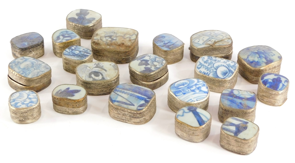 A collection of Chinese boxes, each with a blue and white porcelain lid and silver coloured metal ba