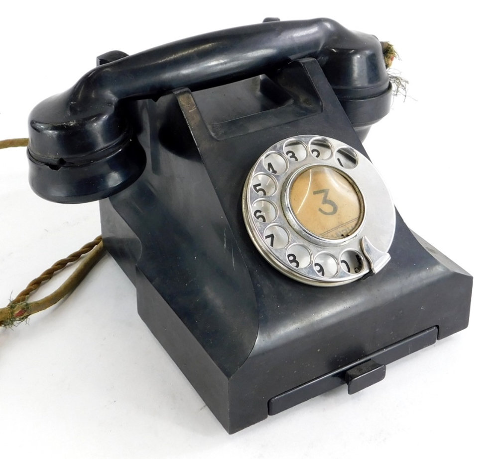 A vintage black Bakelite telephone, stamped to underside 4509B. (AF)