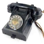 A vintage black Bakelite telephone, number to underside 4509B. (AF)