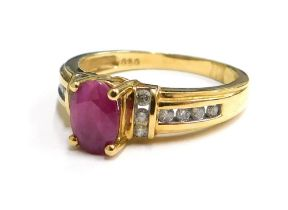 An 18ct gold ruby and diamond dress ring, the oval and cut ruby in four claw setting, with six diamo