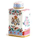 A continental porcelain tea caddy and lid, decorated in Chinese armorial style, pseudo mark to under
