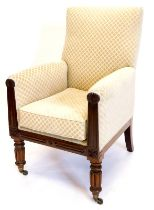A William IV mahogany armchair, upholstered in patterned fabric, the channelled arm supports headed