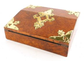 A Victorian figured walnut and brass writing slope, the hinged lid enclosing a velvet lined interior
