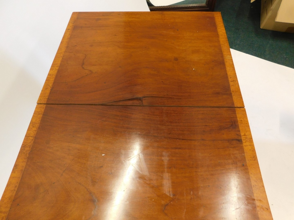 A mahogany and satinwood crossbanded sofa table, the rectangular top with rounded corners above two - Image 2 of 2