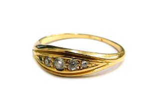 A diamond set dress ring, set with five tiny diamonds in diamond shaped ring head, in a yellow metal