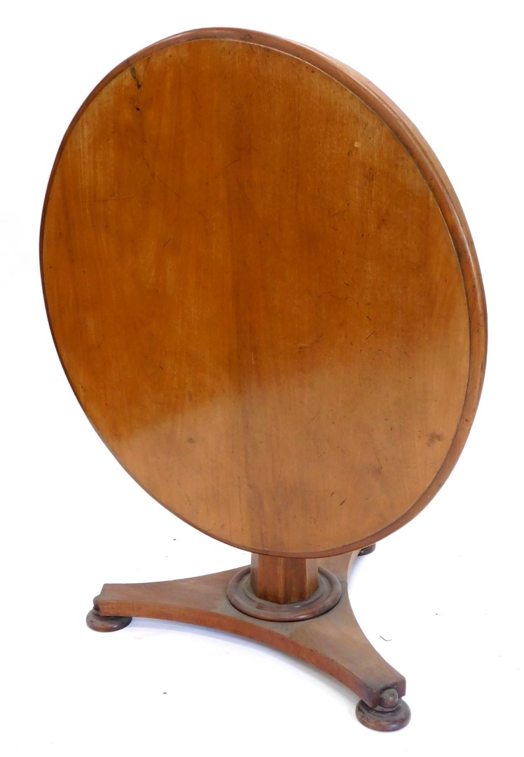 A Victorian mahogany breakfast table, the circular top with a moulded edge, on an octagonal tapering