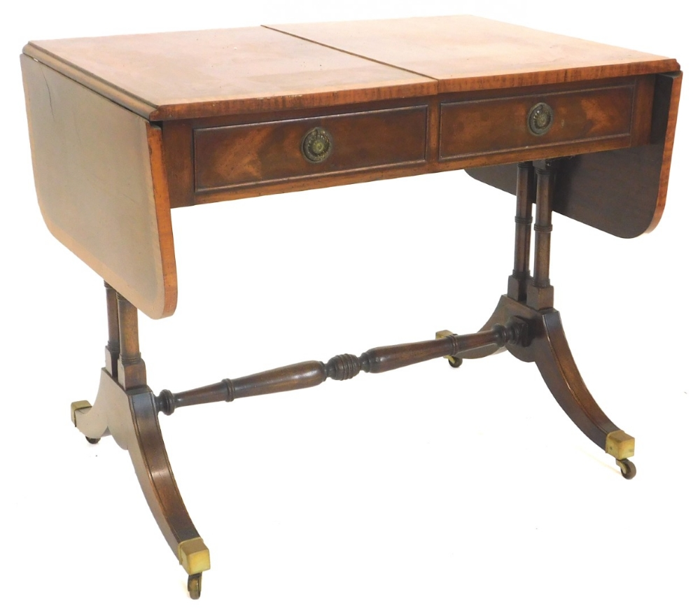 A mahogany and satinwood crossbanded sofa table, the rectangular top with rounded corners above two