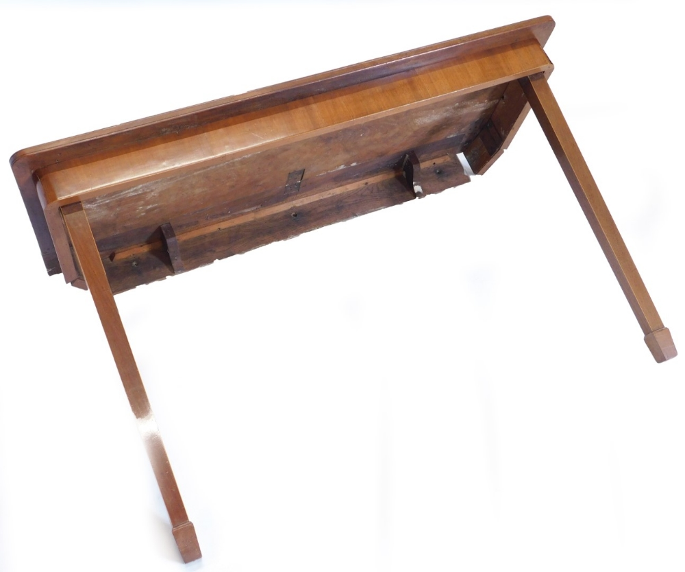 A mahogany folding table, the rectangular crossbanded top above a plain frieze on two hinged square