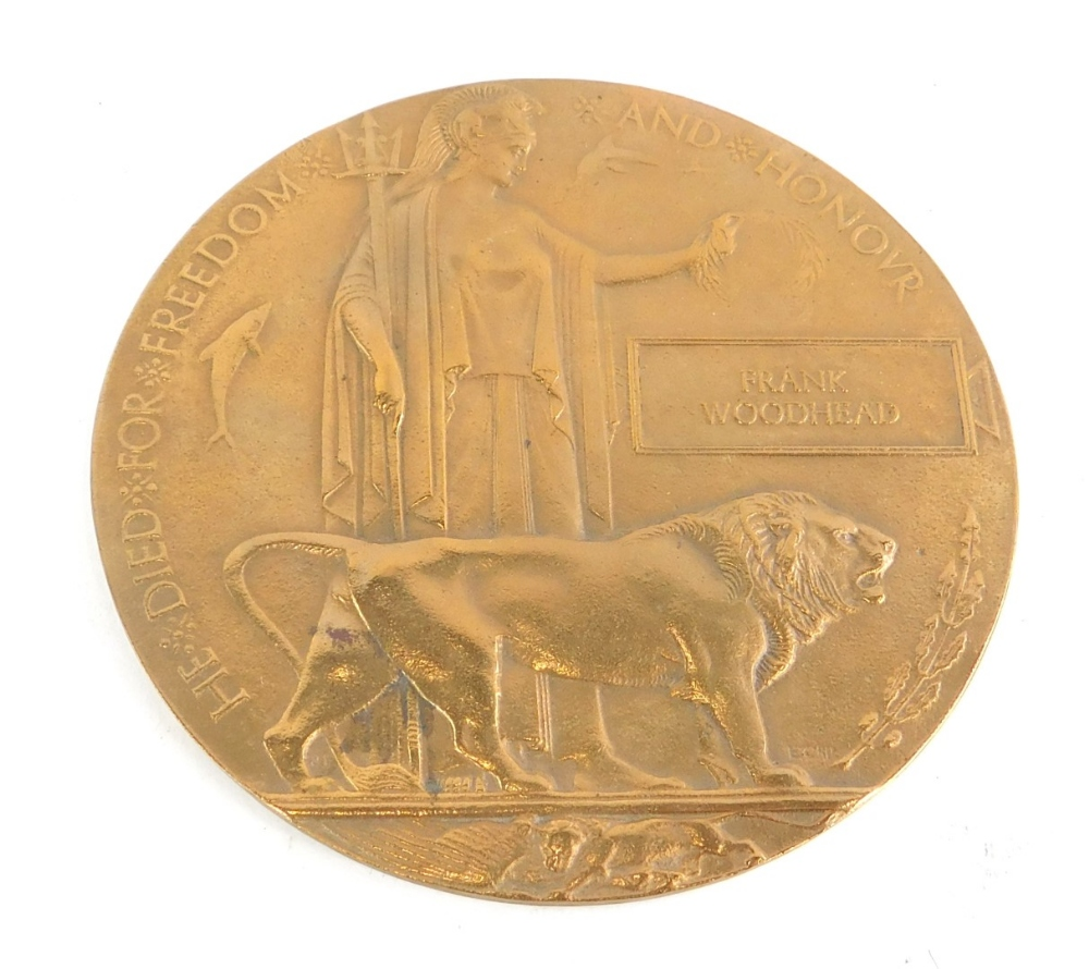 A World War One Death Penny awarded to a Frank Woodhead, in original card case.