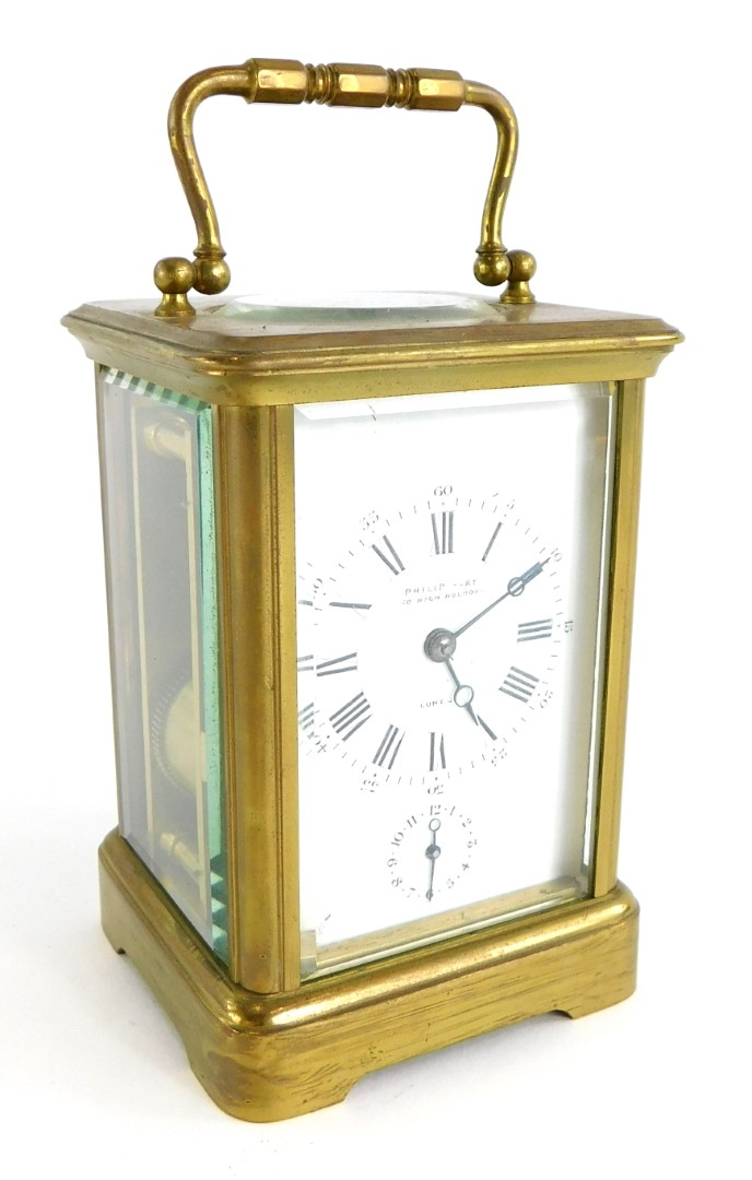 A late 19th/early 20thC French brass carriage clock, the white enamelled dial stamped Philip Hart, L