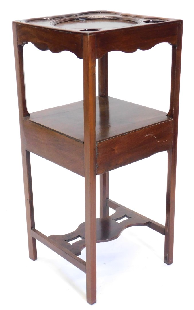 A 19thC mahogany washstand, the square top with a recess for a bowl, beakers, etc., on plain support