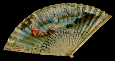 A 19thC continental fan, painted with figures within a landscape, a musician, etc, within a floral b
