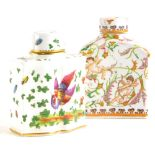 A continental porcelain tea caddy and cover, of shaped form, decorated with Asiatic pheasant, flower