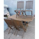 A teak garden table and four folding chairs, various garden tools, to include spades, forks, etc. (a