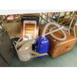 A three fold firescreen, galvanised metal watering can, vacuum cleaner, halogen heater, travelling t