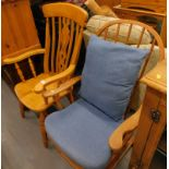 A Durail Glide R motion chair, adapted, and a slat back grandfather chair. (2) The upholstery in thi