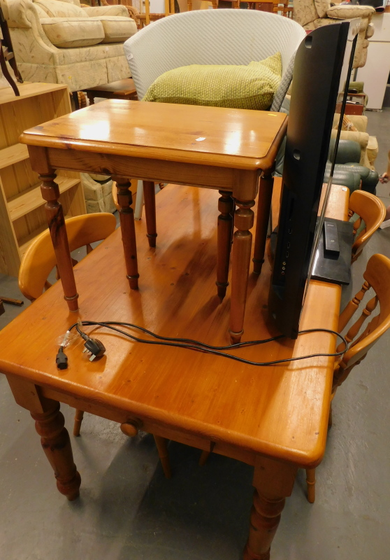 A pine kitchen table, the top 151cm x 81cm, a set of four associated kitchen chairs, a Lloyd Loom st