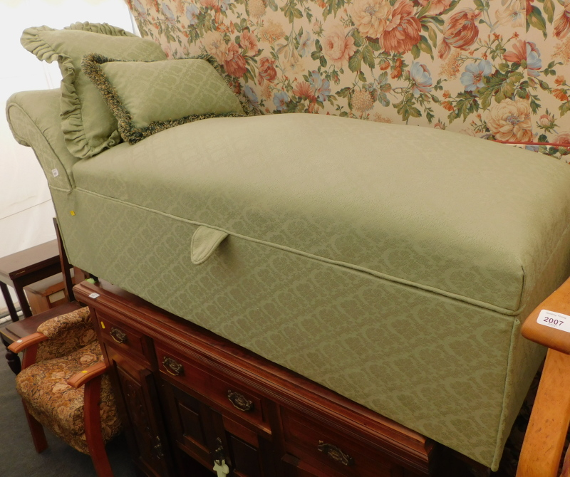A green upholstered day bed/ottoman.