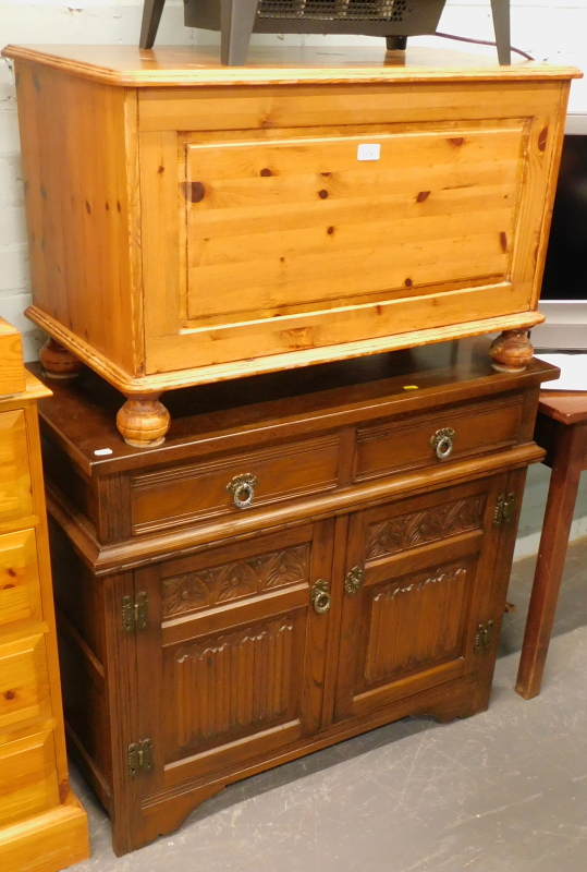 A pine blanket box, with hinged lid, on ball feet, 52cm high, 80cm wide, 41cm deep, and an Old Charm