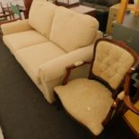 A two seater sofa bed, in cream fabric, and a armchair, with padded seat back and armrest, on cabrio