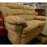 A floral upholstered two seater sofa.