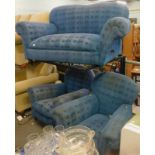 A two seater drop arm sofa, and two matching armchairs, in blue geometric patterned fabric.