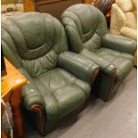 A pair of green leather armchairs.