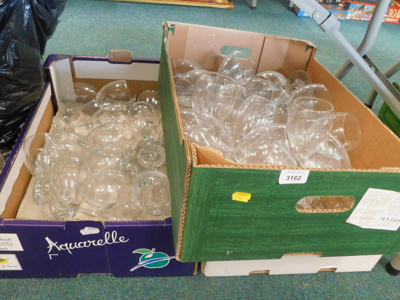 A large quantity of drinking glasses.