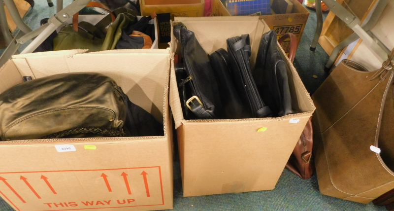 A quantity of ladies handbags, to include leather shoulder bags, etc. (contents of under 1 table)