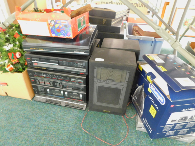 A Fisher music system, comprising turntable, cassette player, a pair of speakers, a Delonghi kettle,