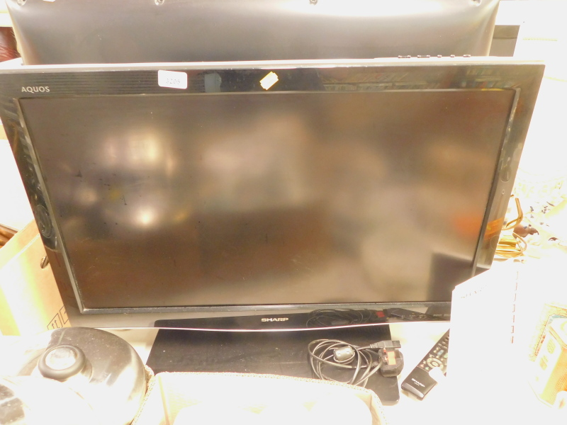 A Sharp Aquos 32inch television, with lead and remote.