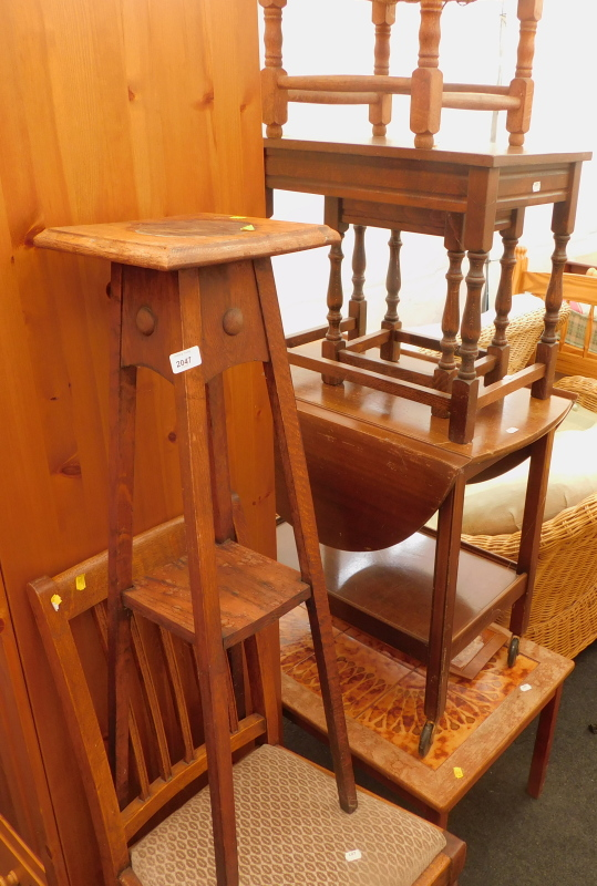 A collection of furniture, to include a mid 20thC tile top teak coffee table, an oak two tier jardin