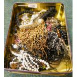 A quantity of costume jewellery, to include faux pearl necklace, beaded necklaces, etc. (1 tin)