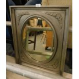 A wall mirror, painted in grey, with moulded flower and leaf decoration, the frame 64cm x 50cm.